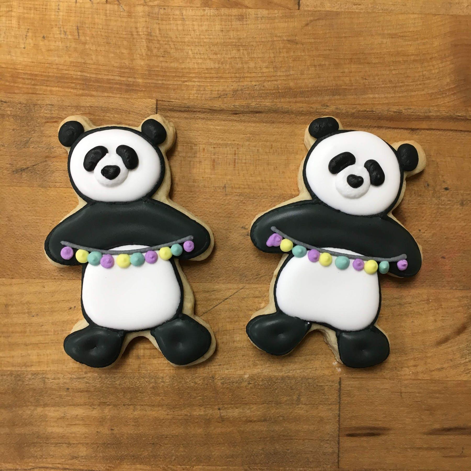 pandas holding a banner