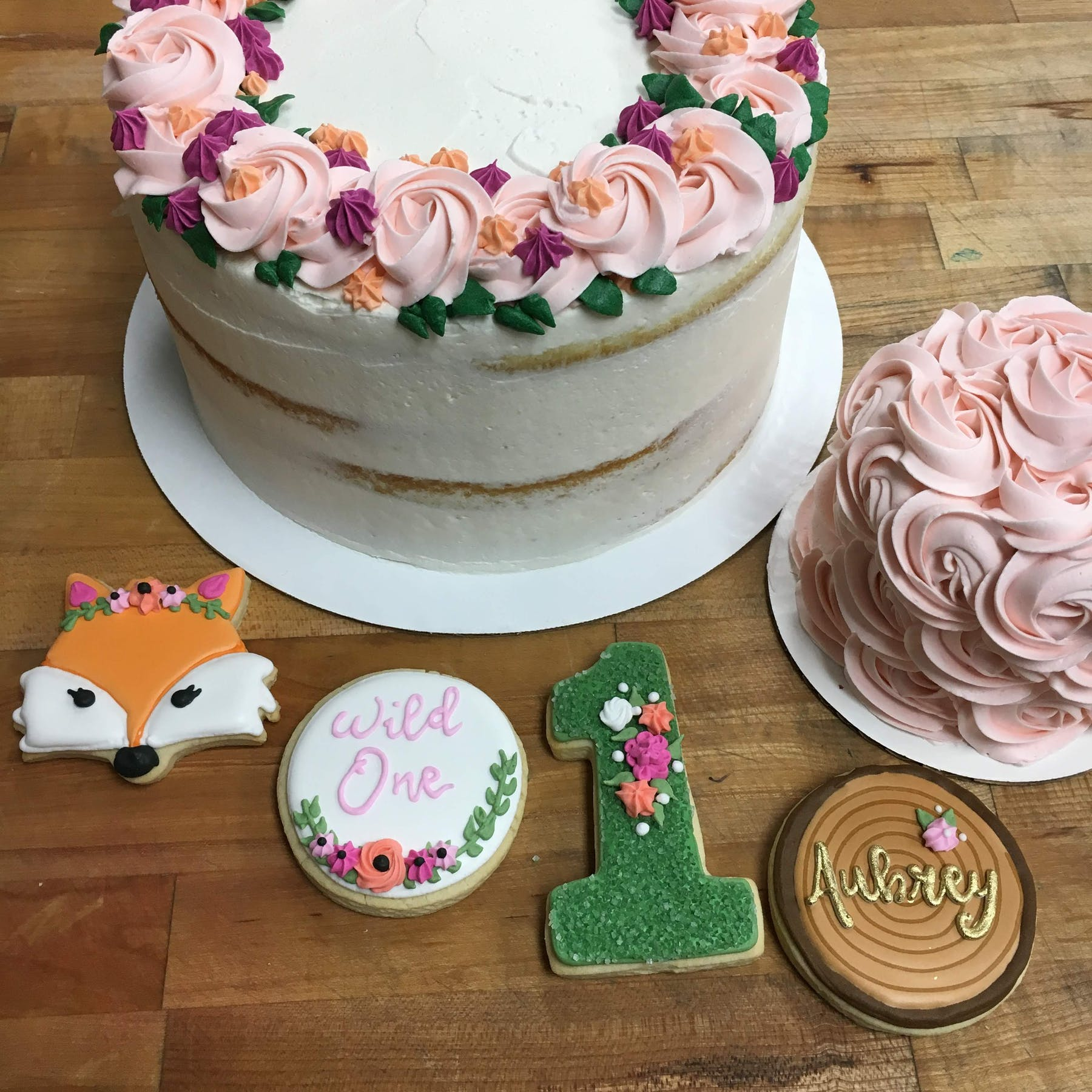 cakes with matching decorated cookies
