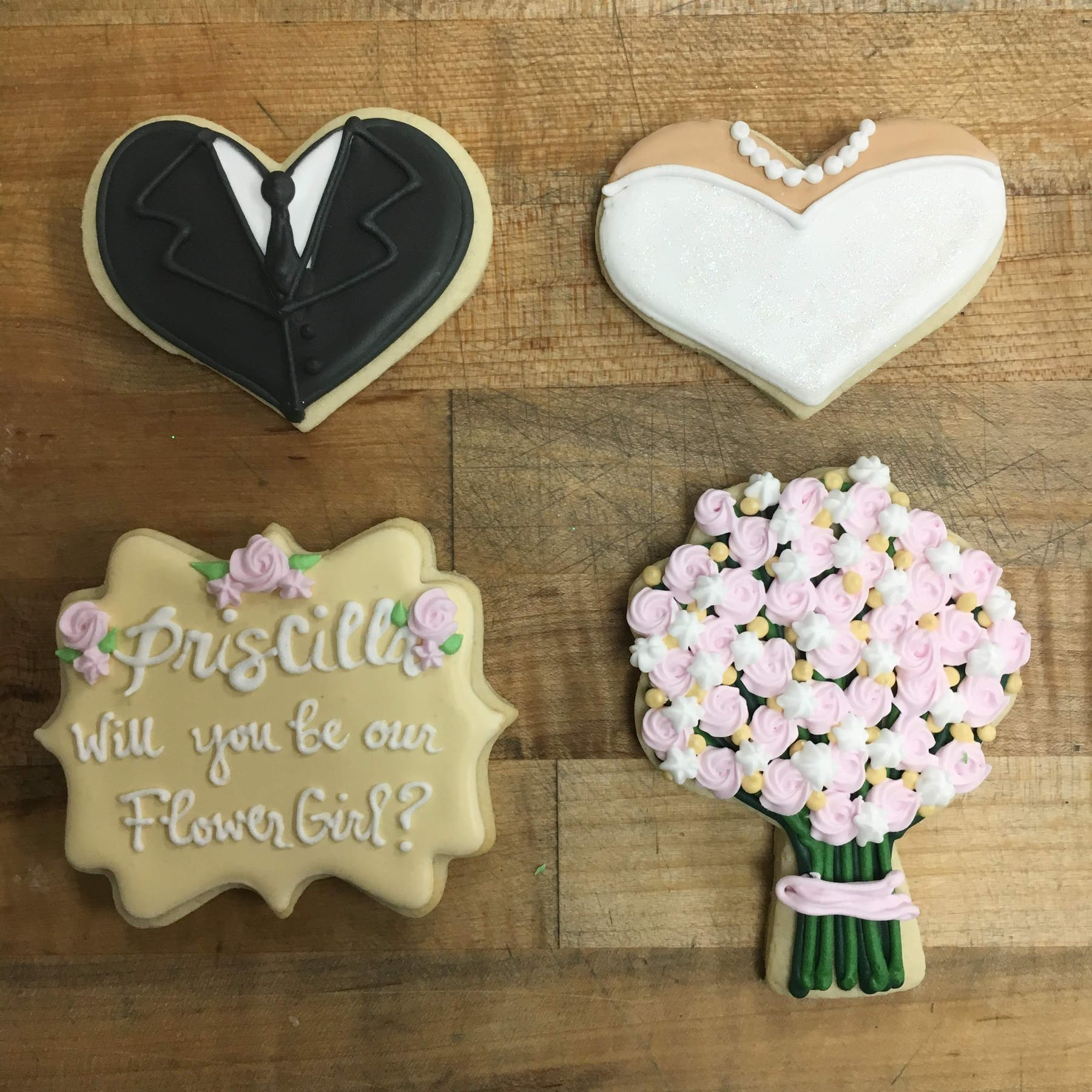 a decorated cookies bridal/wedding on a table