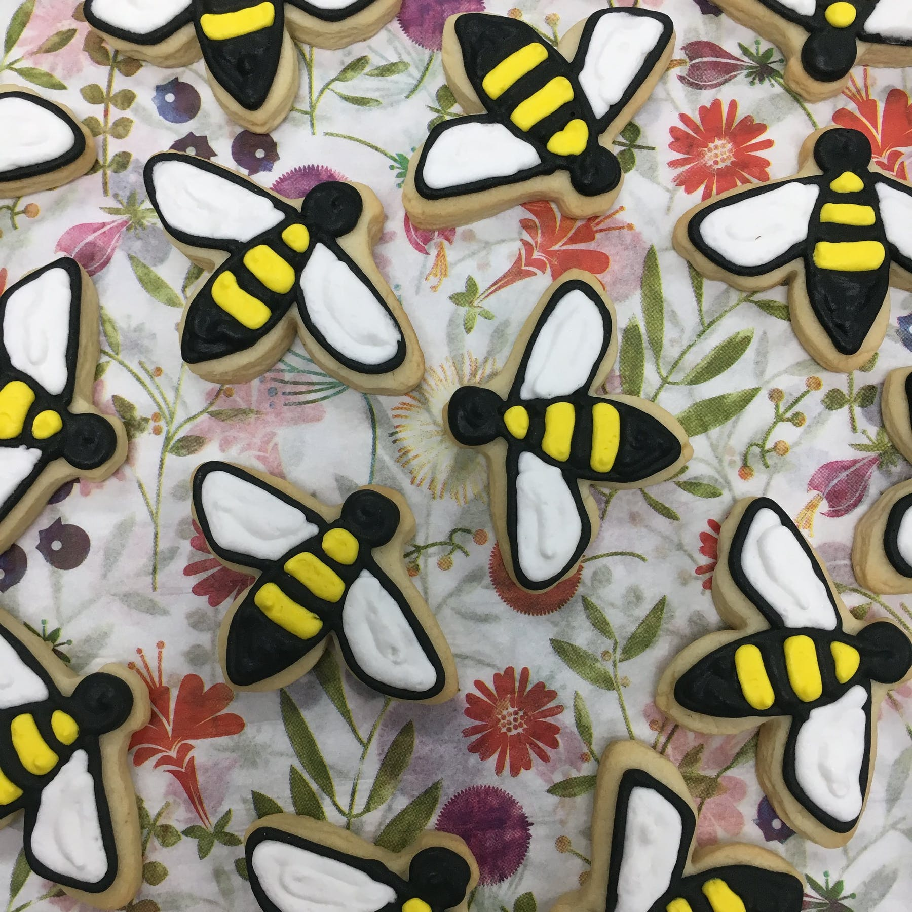 bees on top of floral paper