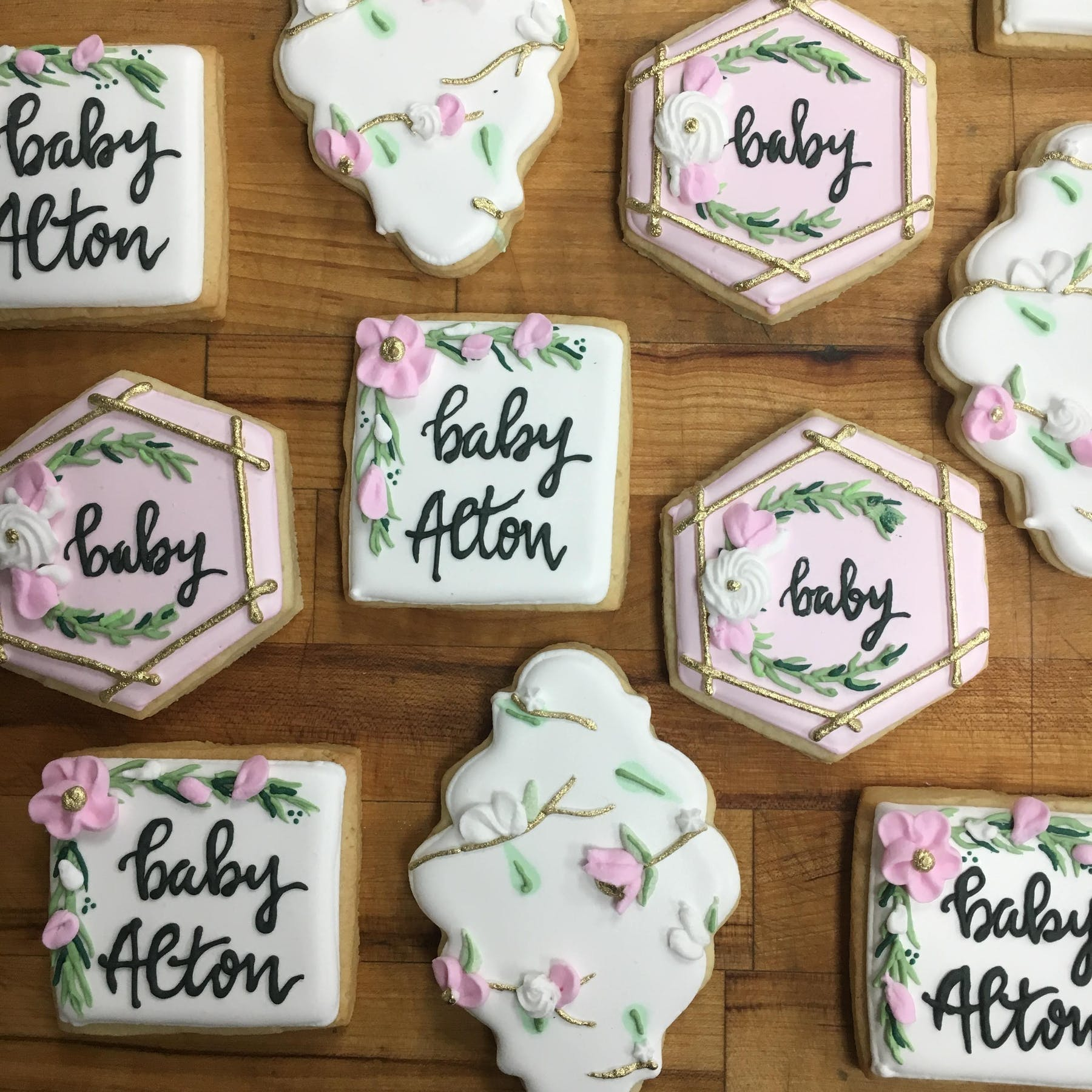 floral themed decorated cookies for baby girl shower