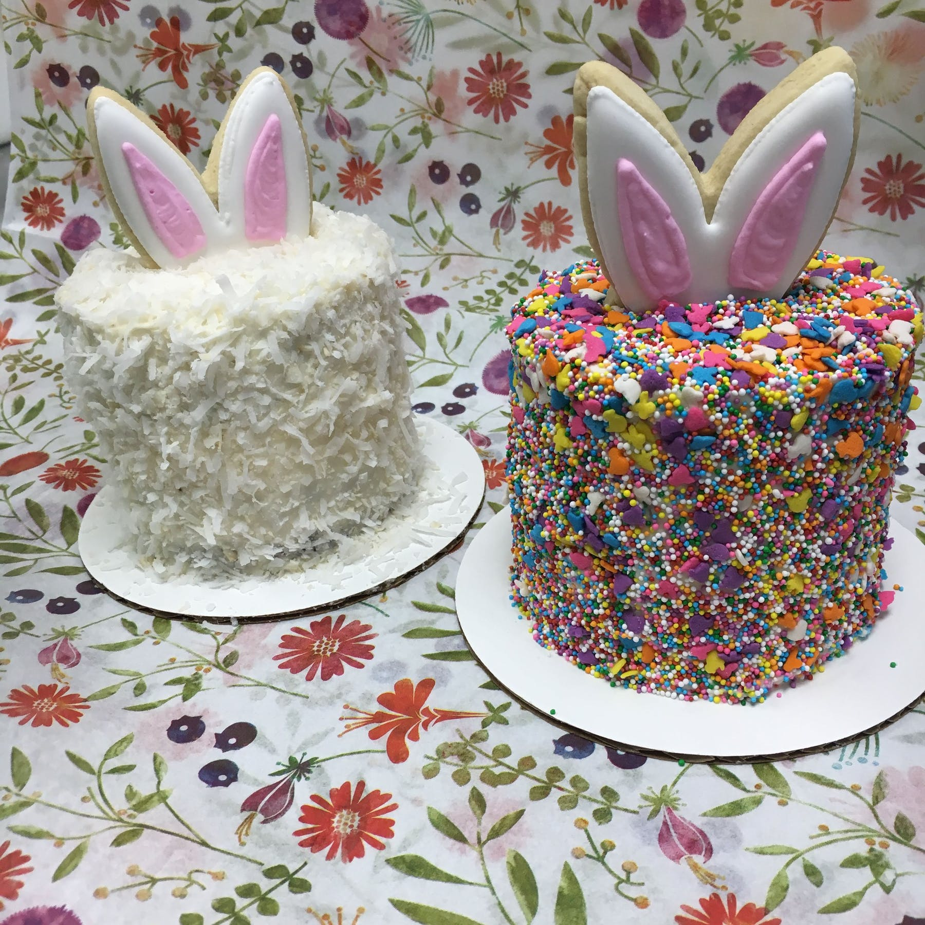 two easter themed cakes