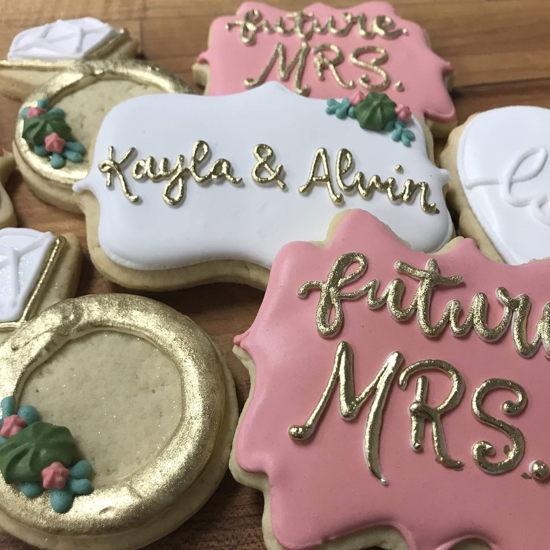 multiple decorated cookies sitting on a table
