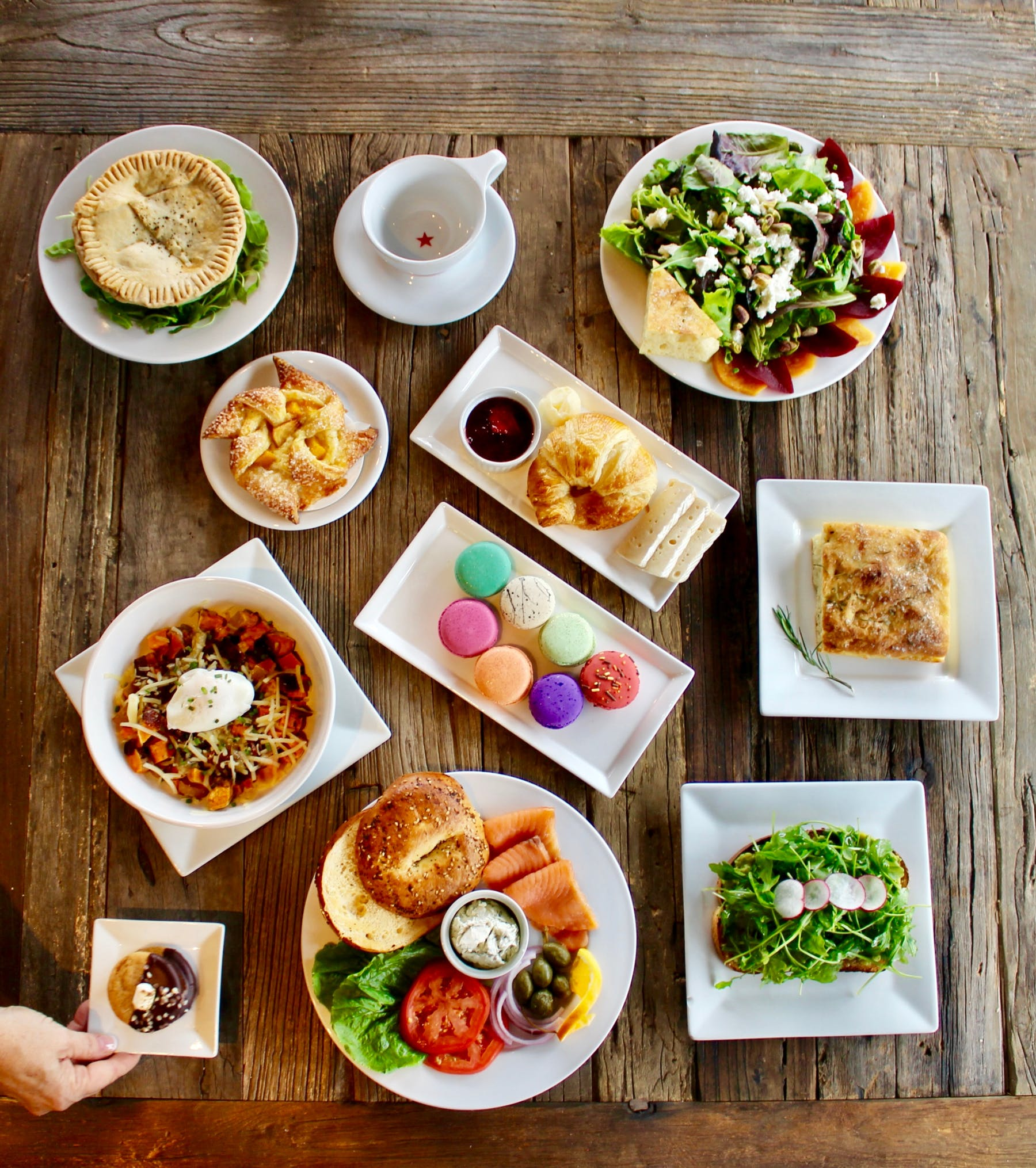 an overview of a table filled with multiple plates of food