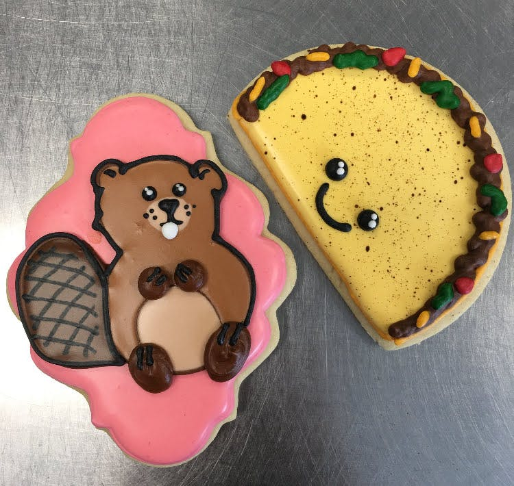 beaver shaped cookies next to a taco shaped cookie
