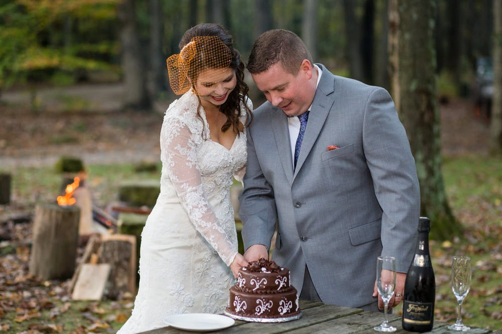 a man and a woman cutting a cake