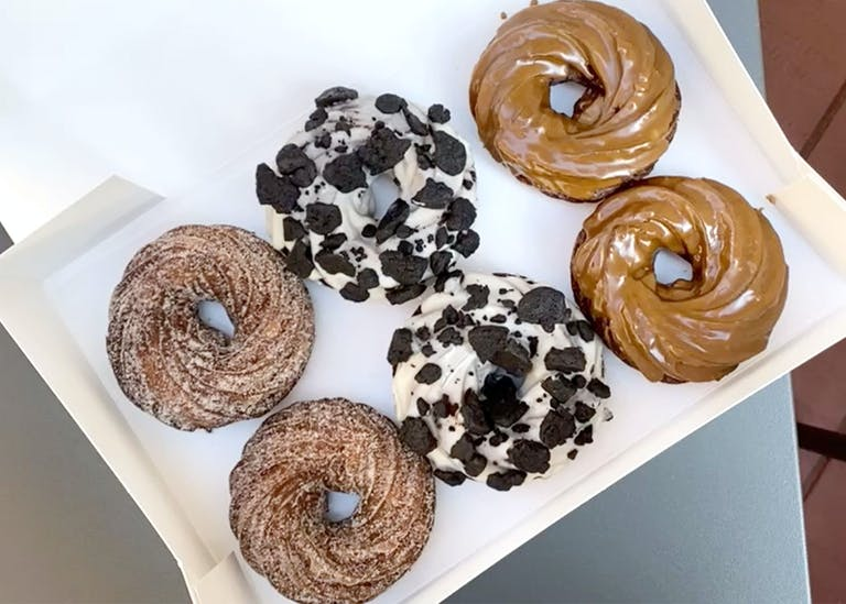 a box filled with different kinds of donuts