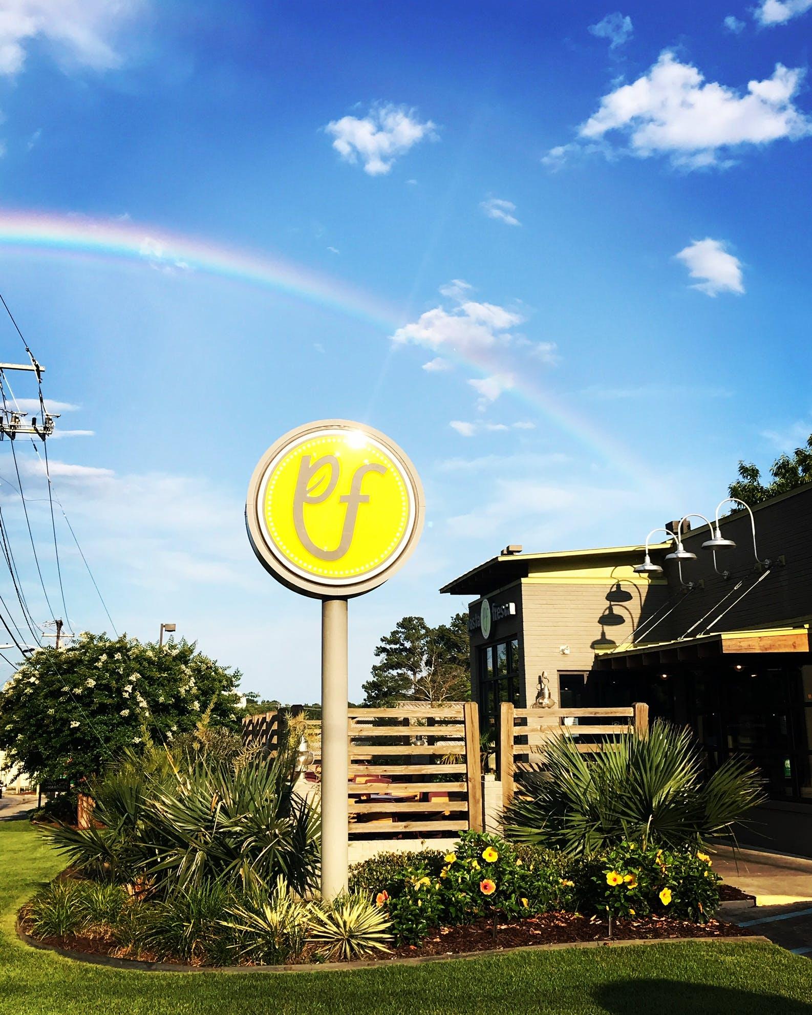 a sign with a rainbow