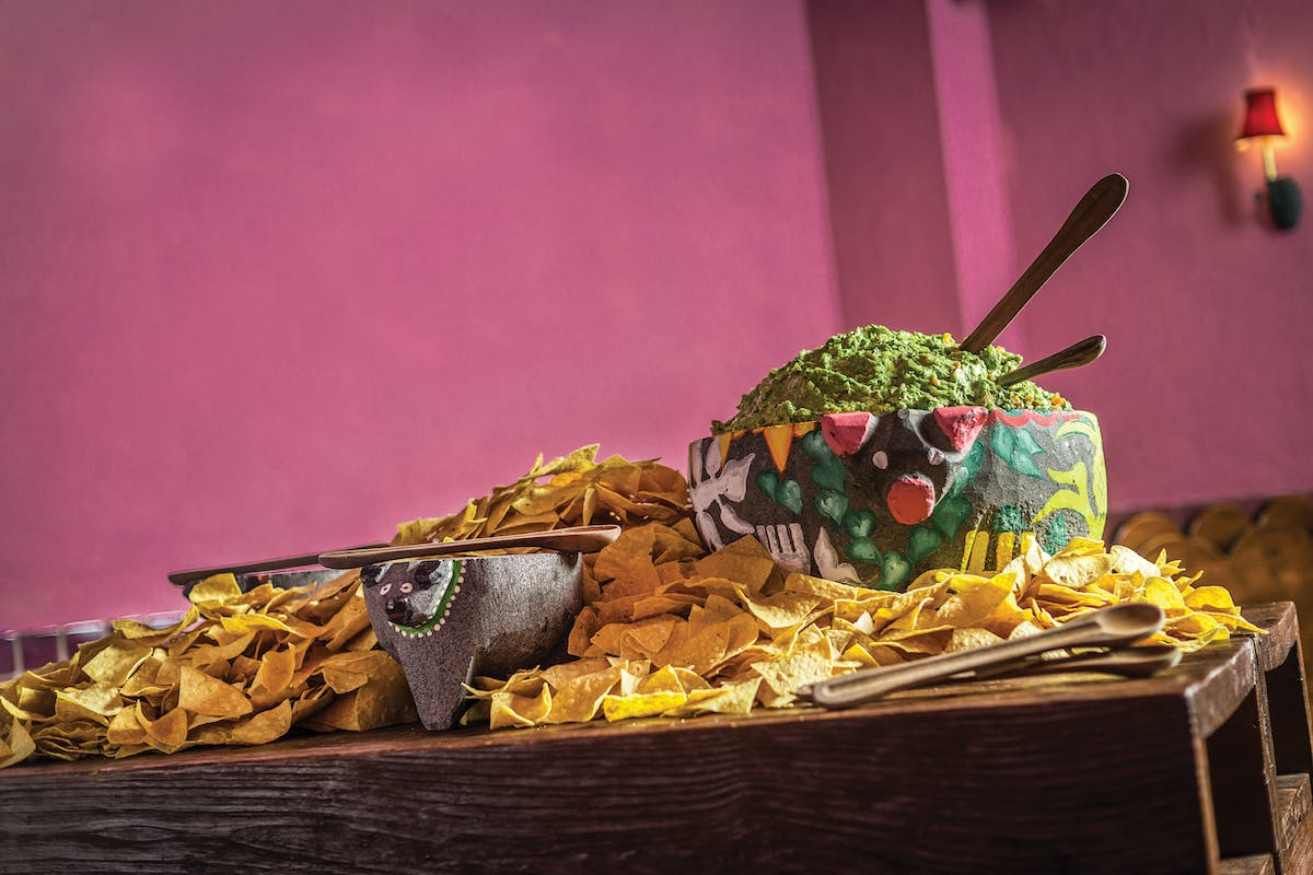 tortilla chips and guacamole on a table
