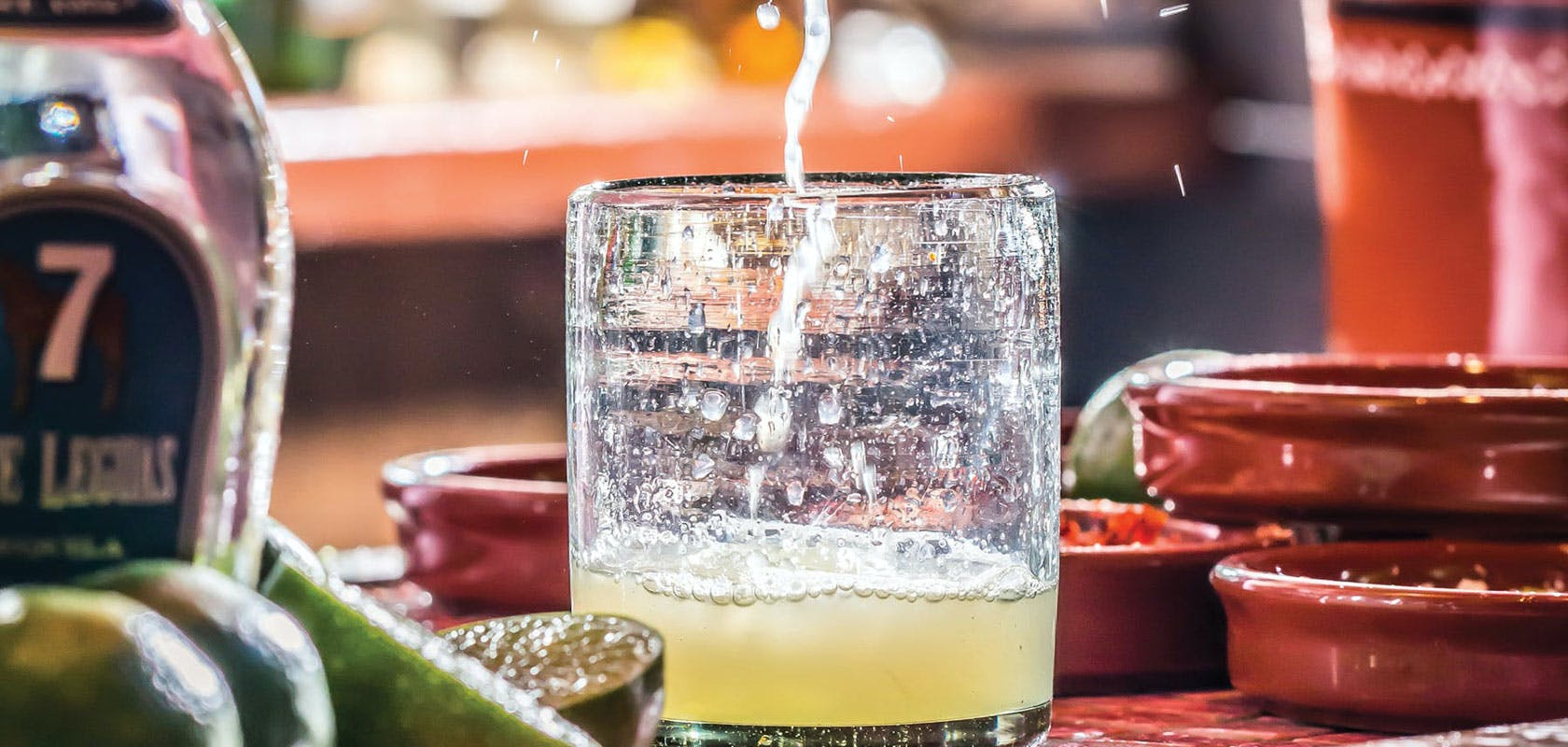 A margarita being made.