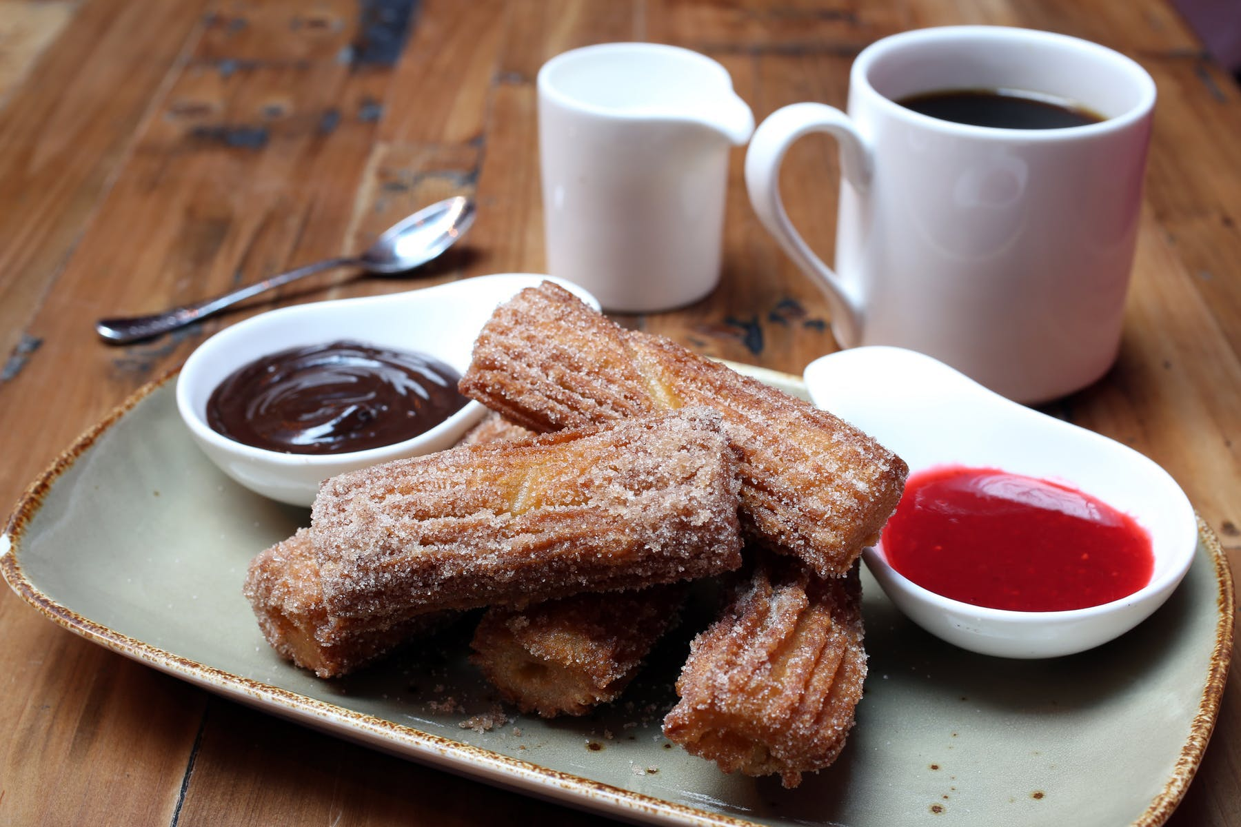 Churros with two sauces on a plate
