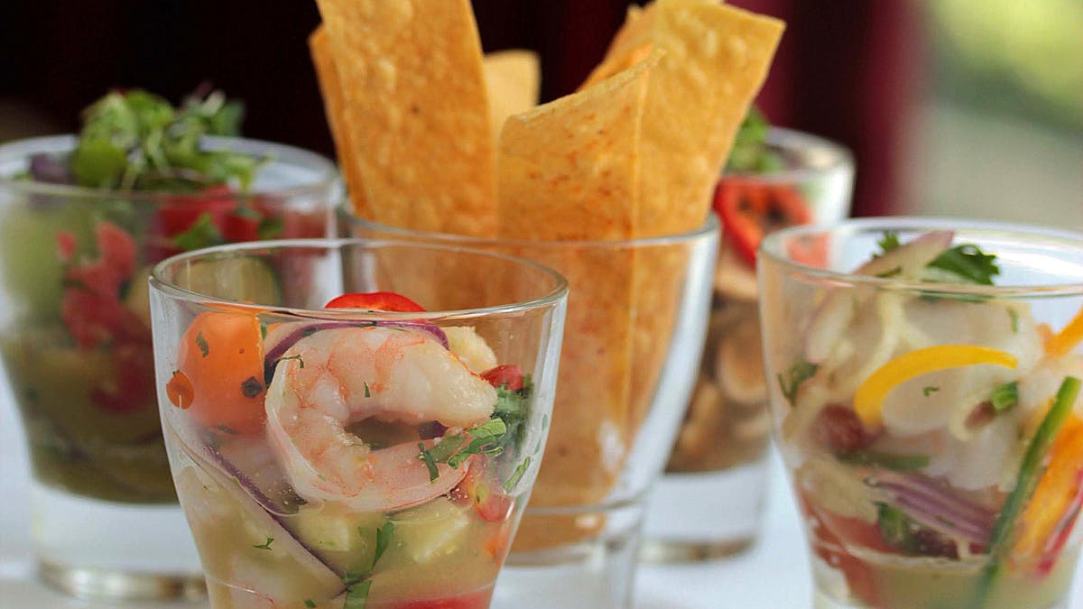 a close up of ceviche sampler