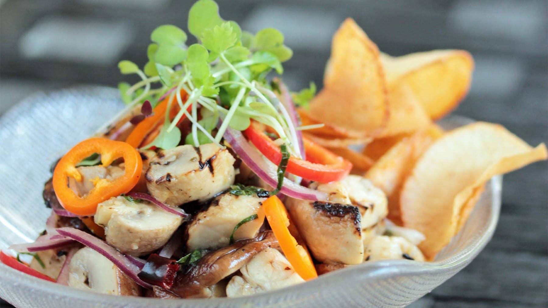 a bowl of mushroom ceviche