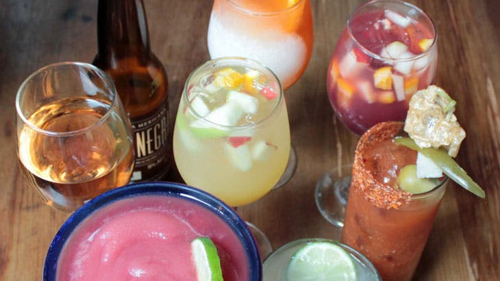 mixed drinks on a wood table