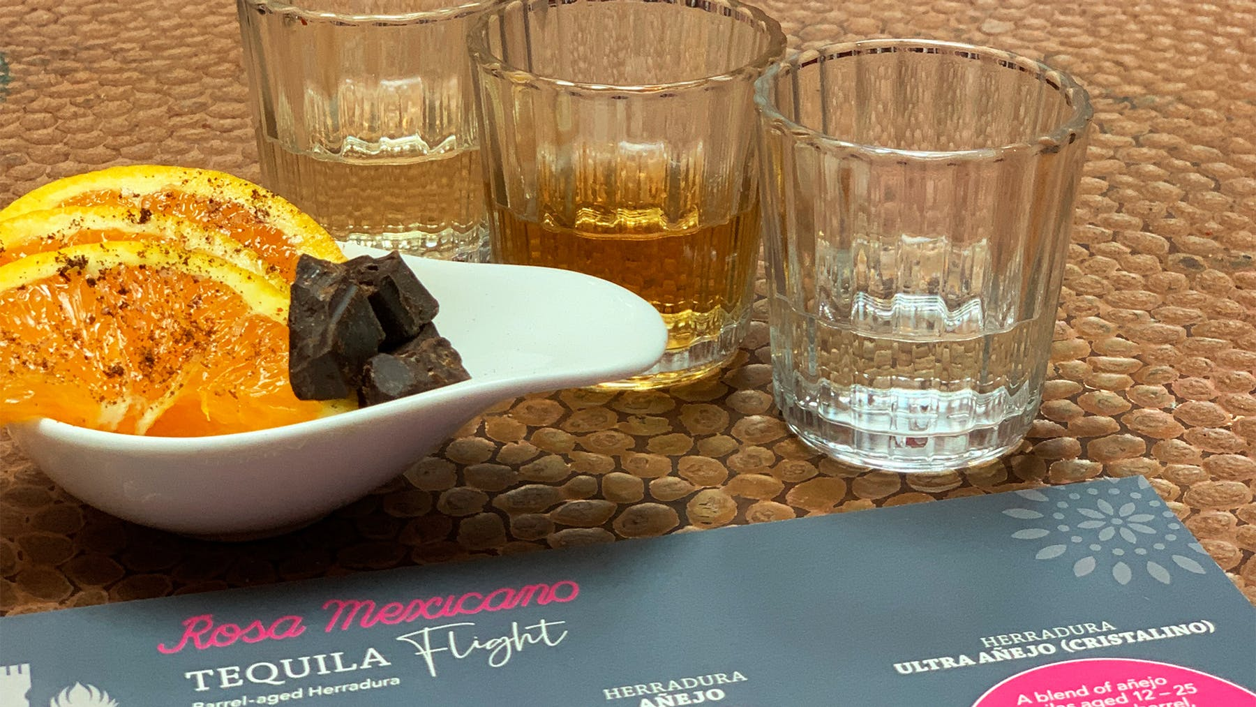 3 small glasses of our Mezcal flights with orange slices and chocolate
