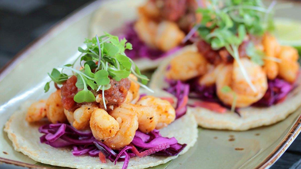 a close up of shrimp tacos