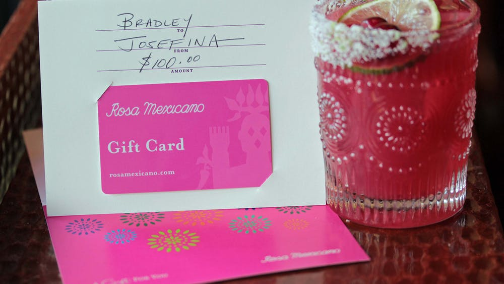 gift card and cocktail on a table