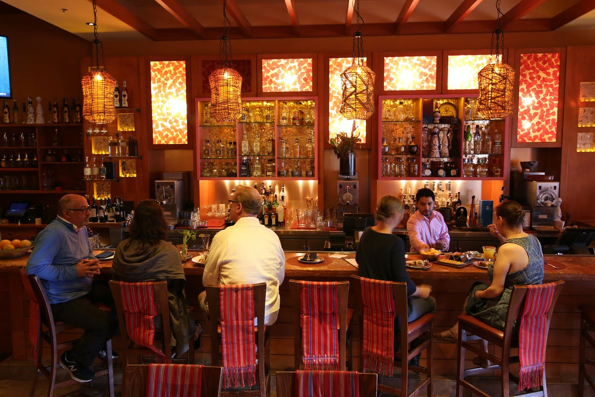 people eating and drinking at bar at Rosa Mexicano in Riverside Square, NJ