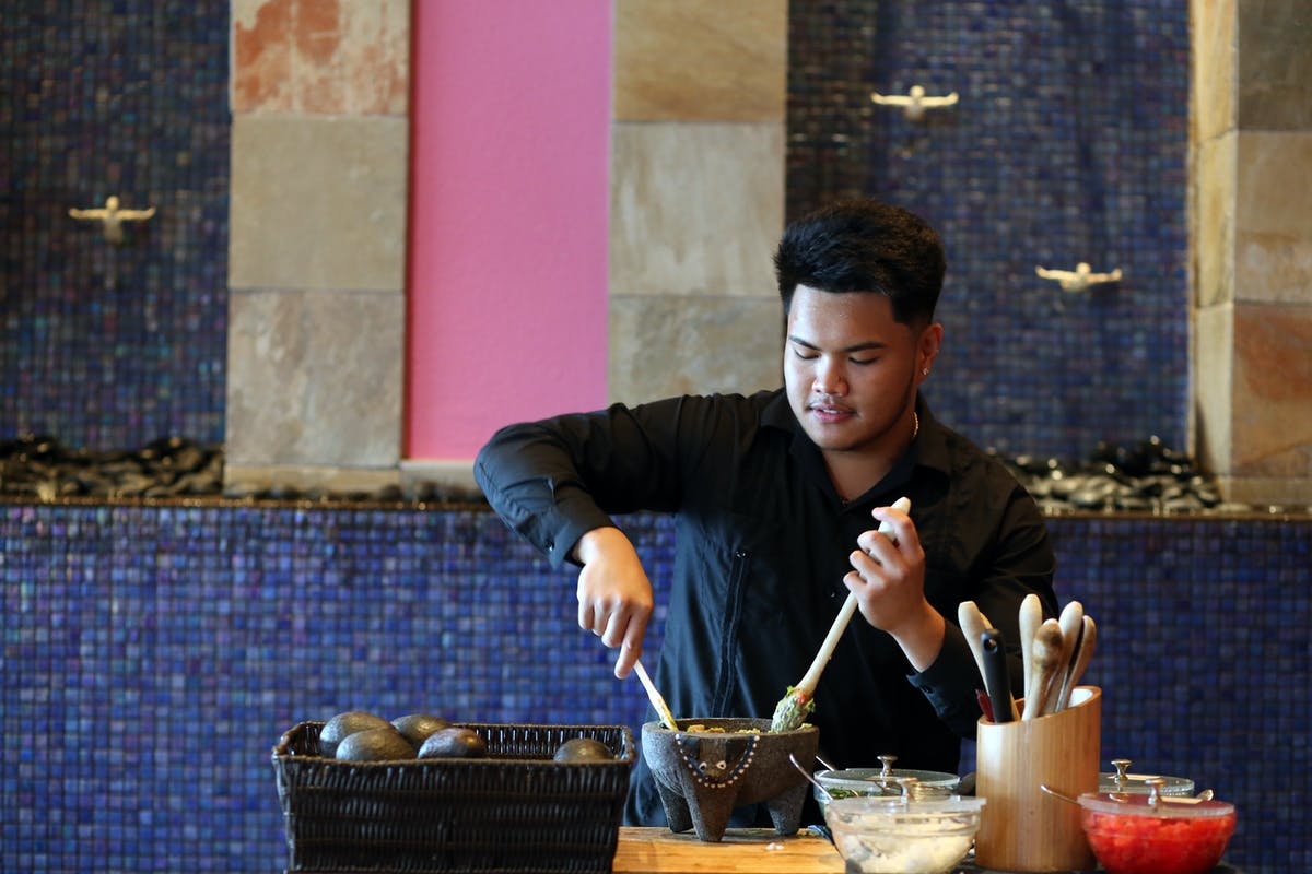 chef making guacomole