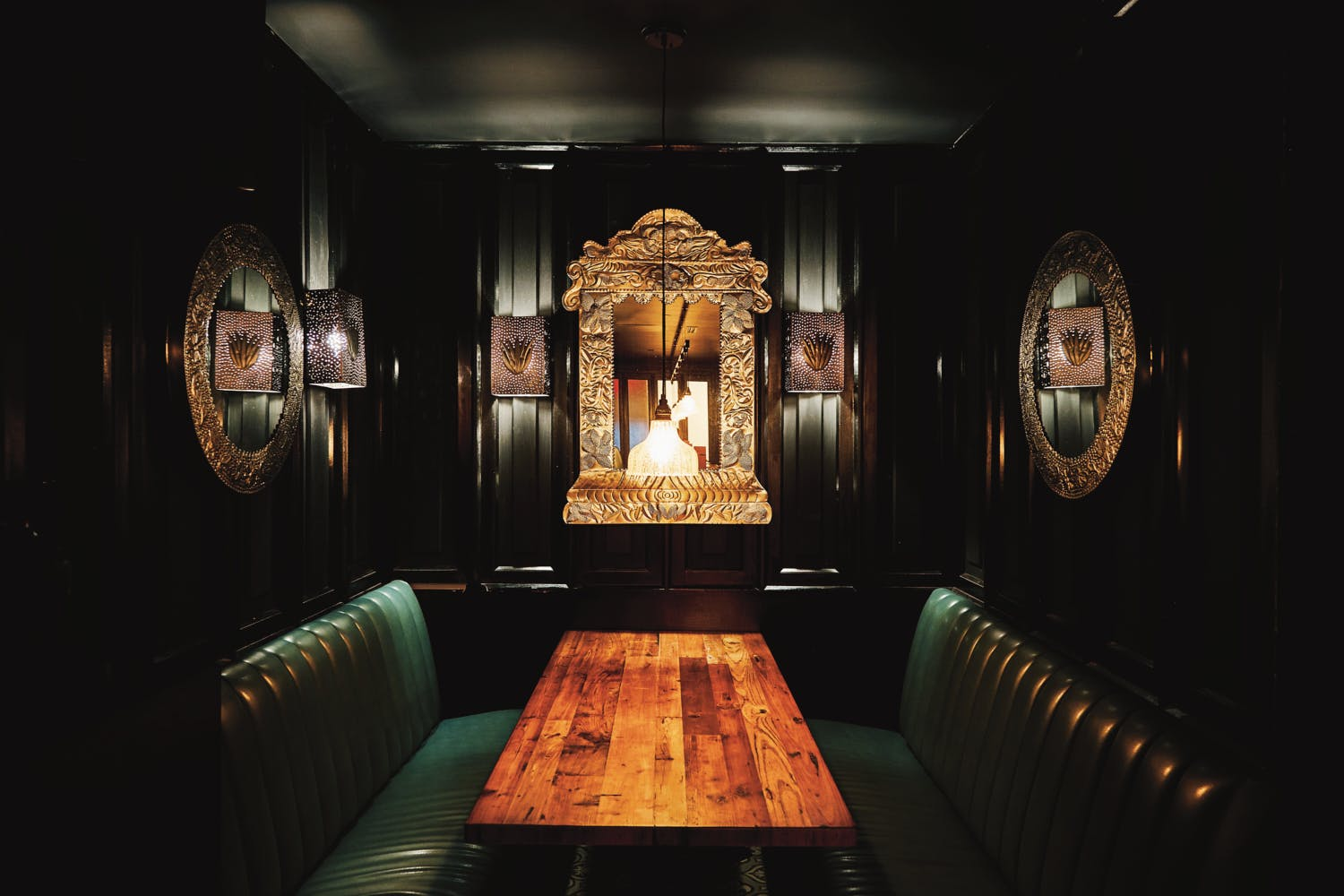 dark romantic dining table at Rosa Mexicano in Tribeca, NY