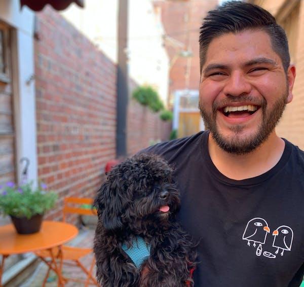 a man holding a dog