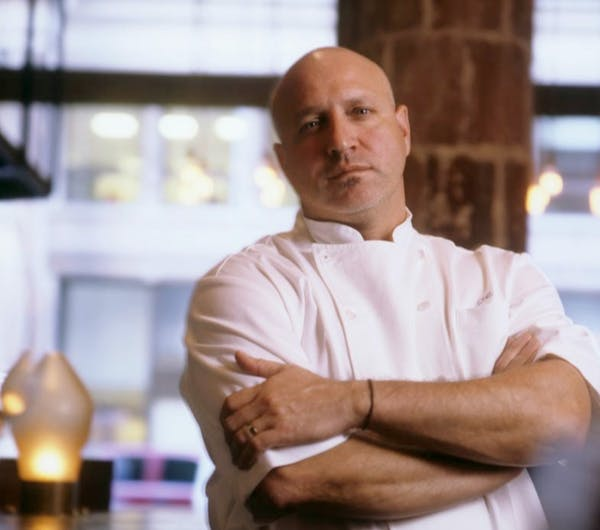 Tom Colicchio sitting on a table