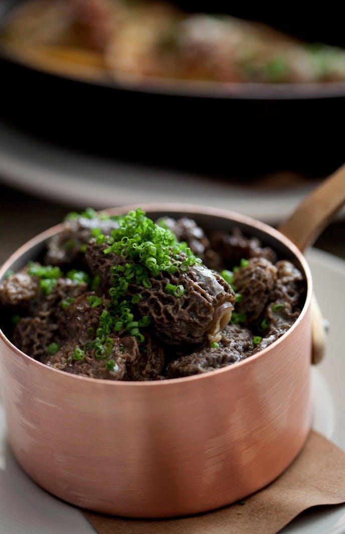 a bowl of morel mushrooms
