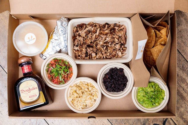 a box filled with different types of food on a plate
