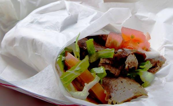 gyro with tomato, onion, tzatziki
