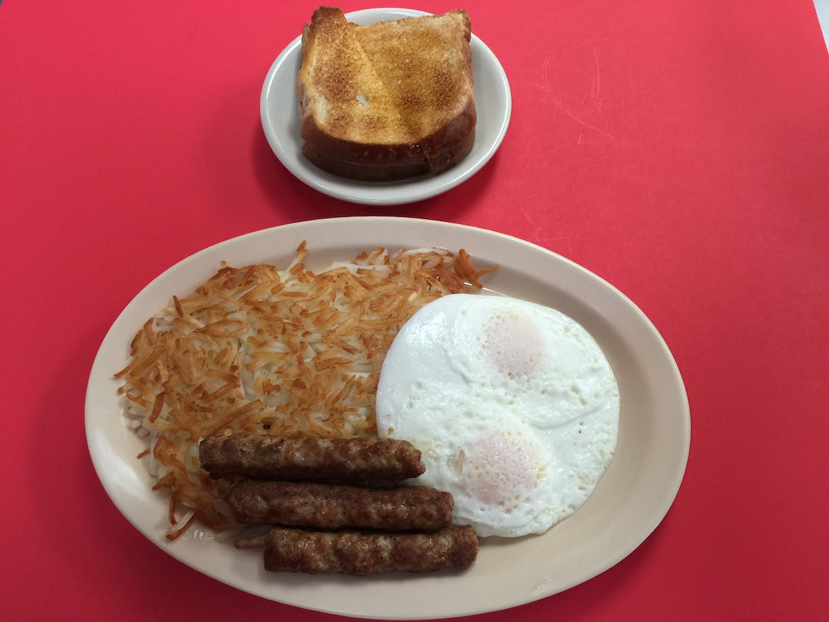 two eggs, hash browns, sausage and toast