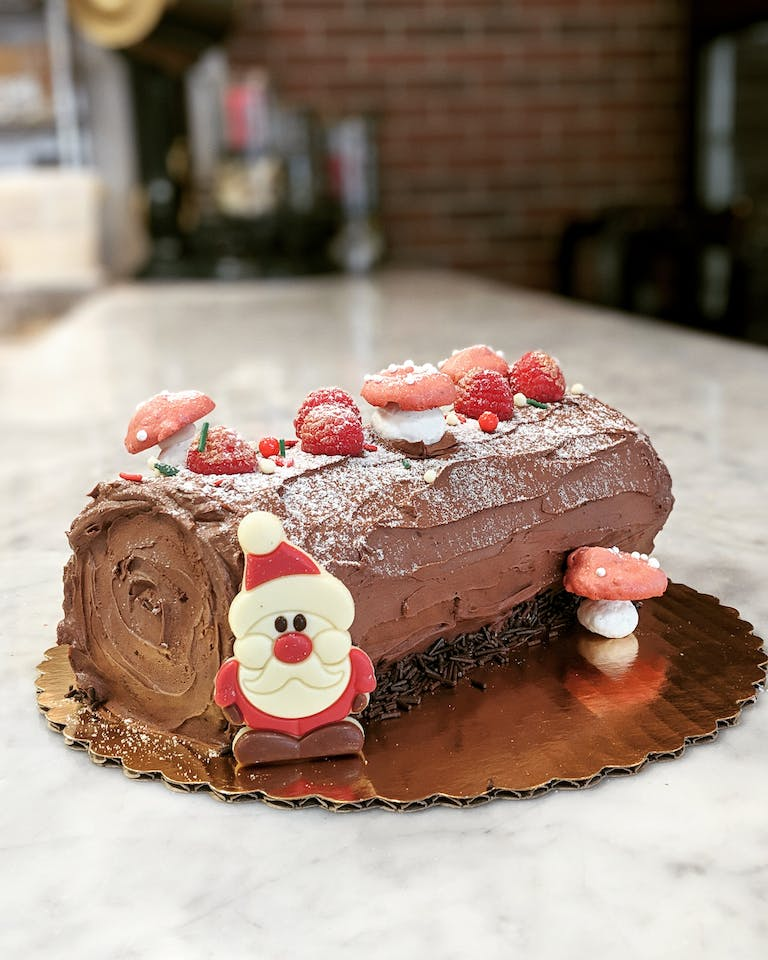 A yule log decorated for Christmas