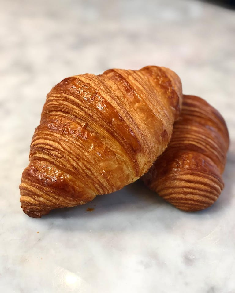 a croissant stacked on another croissant