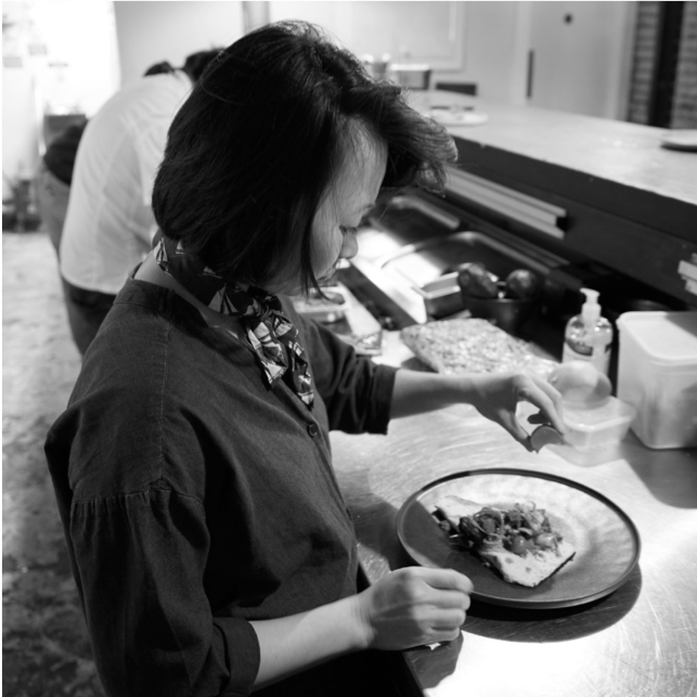 a person preparing food in a kitchen