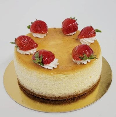 a slice of cake with fruit on a plate