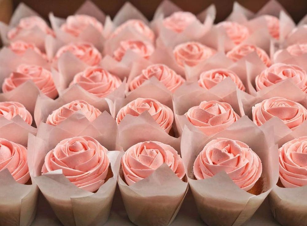 a group of pink and white cake