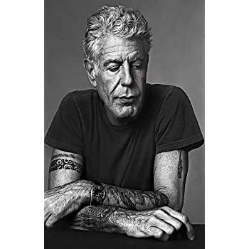 Anthony Bourdain sitting on a table