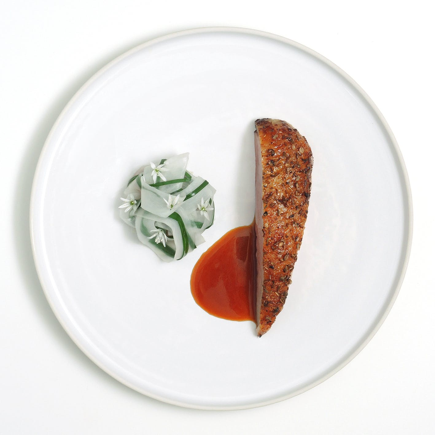 a plate of food with a slice cut out