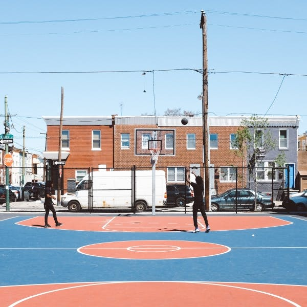 a group of people on a basketball court