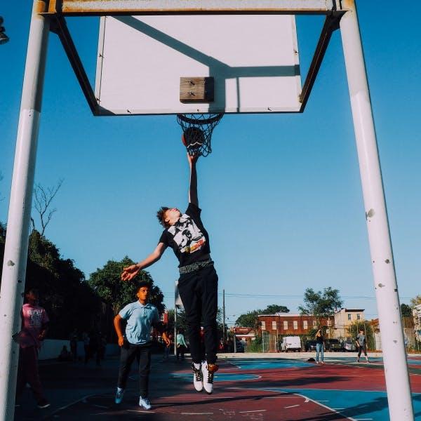 a man holding a basketball