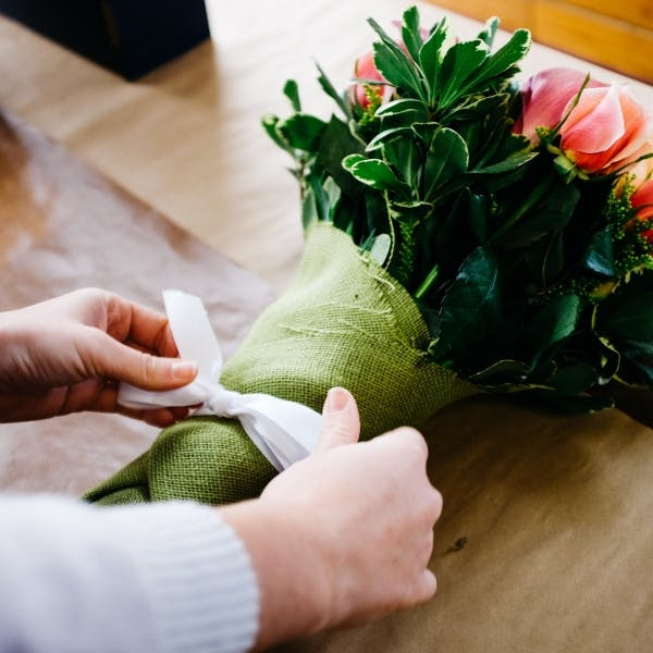 a hand holding flowers
