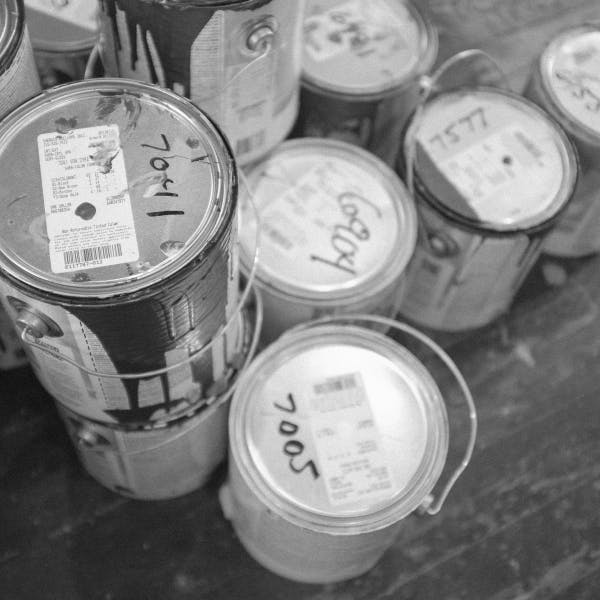 a group of paint cans