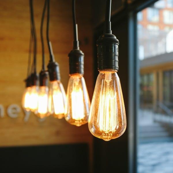some lit up light bulbs