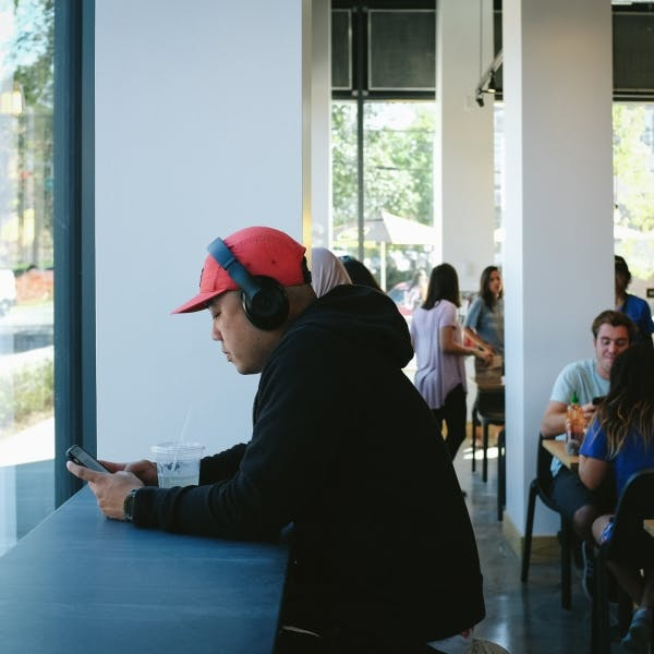 a group of people sitting at a table in front of a window