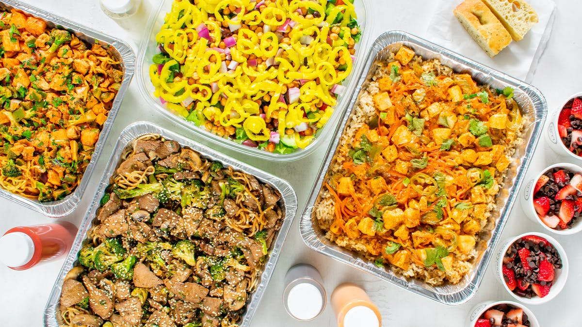 a plastic container filled with different types of food on a table