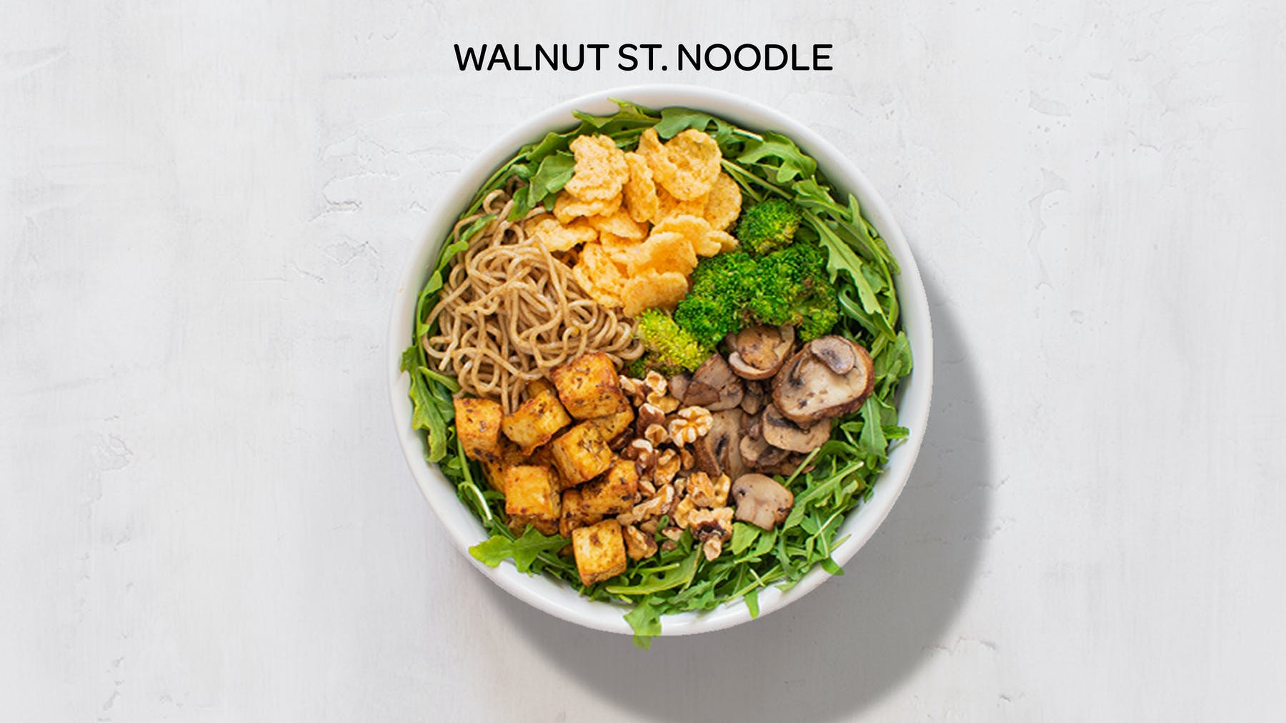 a bowl of walnut st. noodle salad