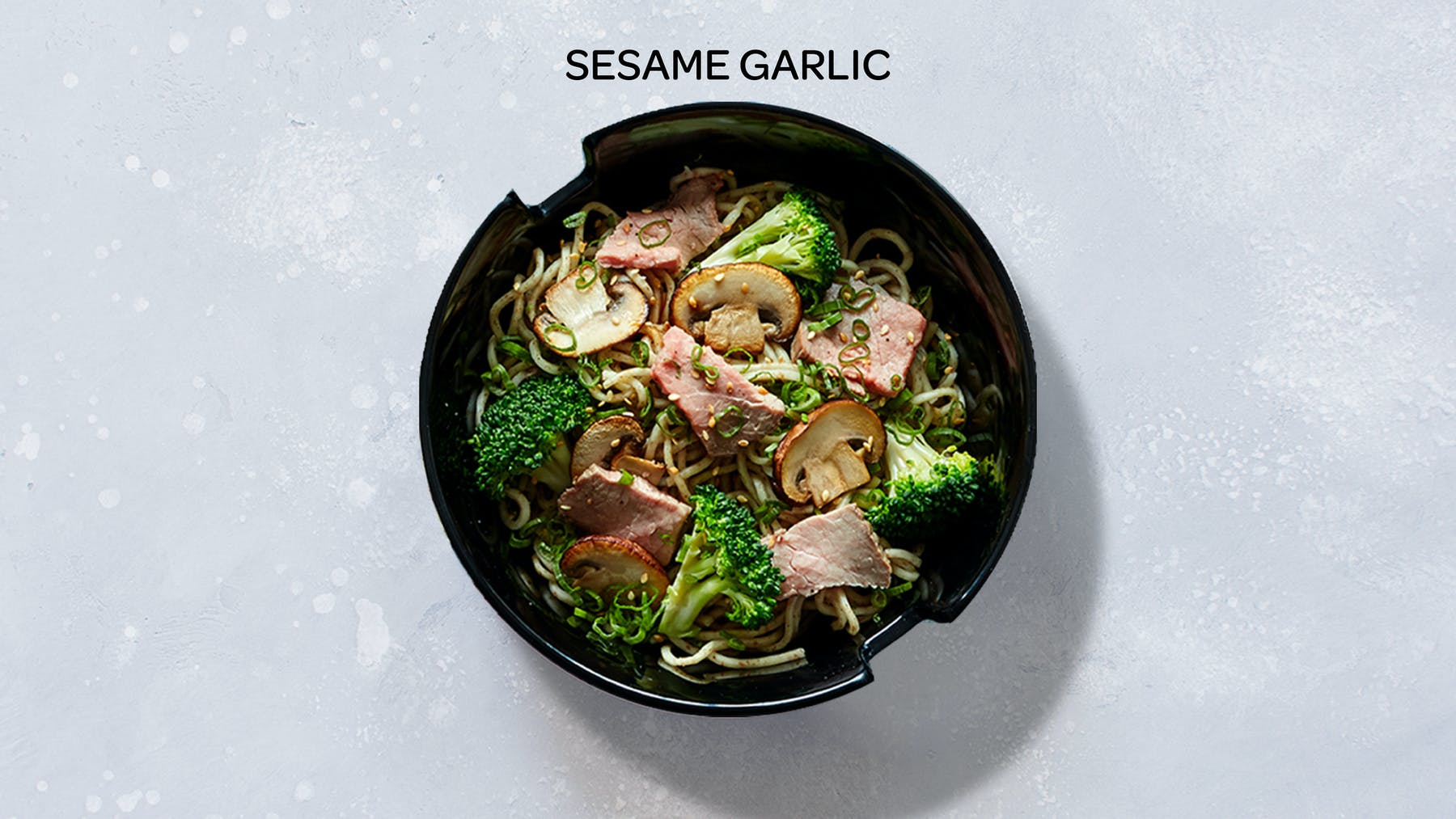 a bowl of sesame garlic stir-fry