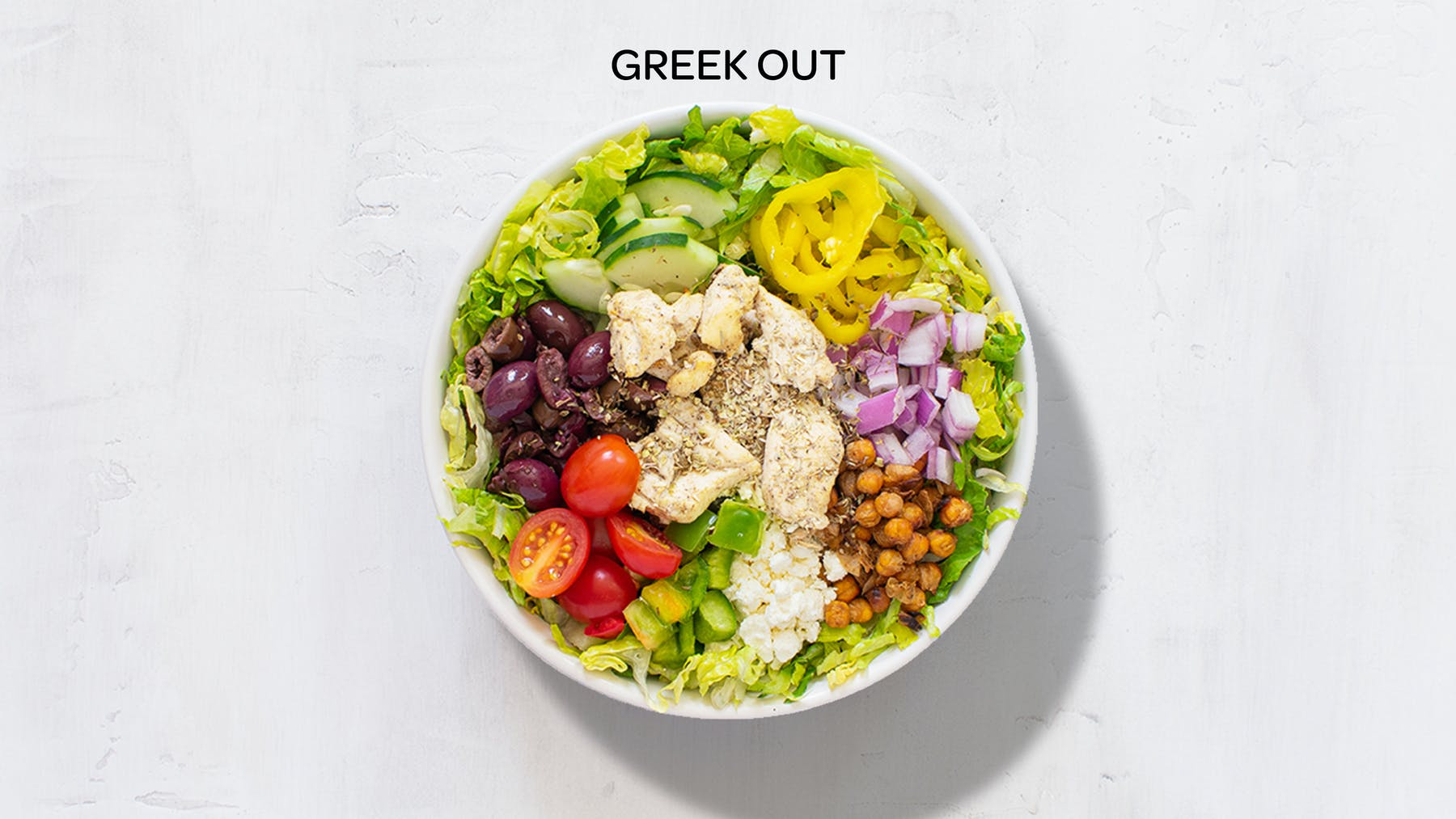 a bowl of greek out salad