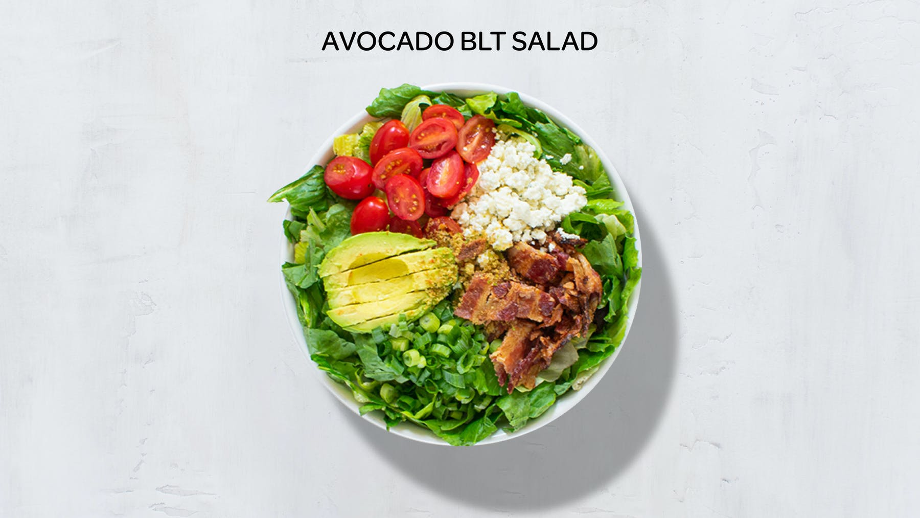 a bowl of avocado blt salad