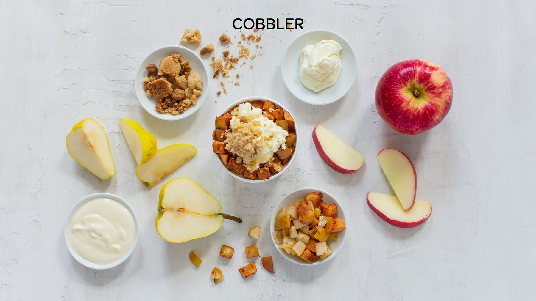 the ingredients of a cobbler honeybar spread out on a table