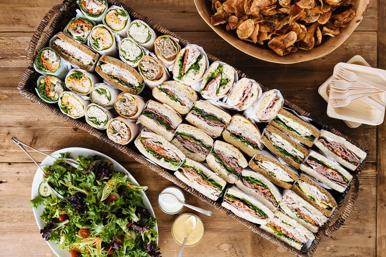 a bunch of food sitting on top of a wooden table
